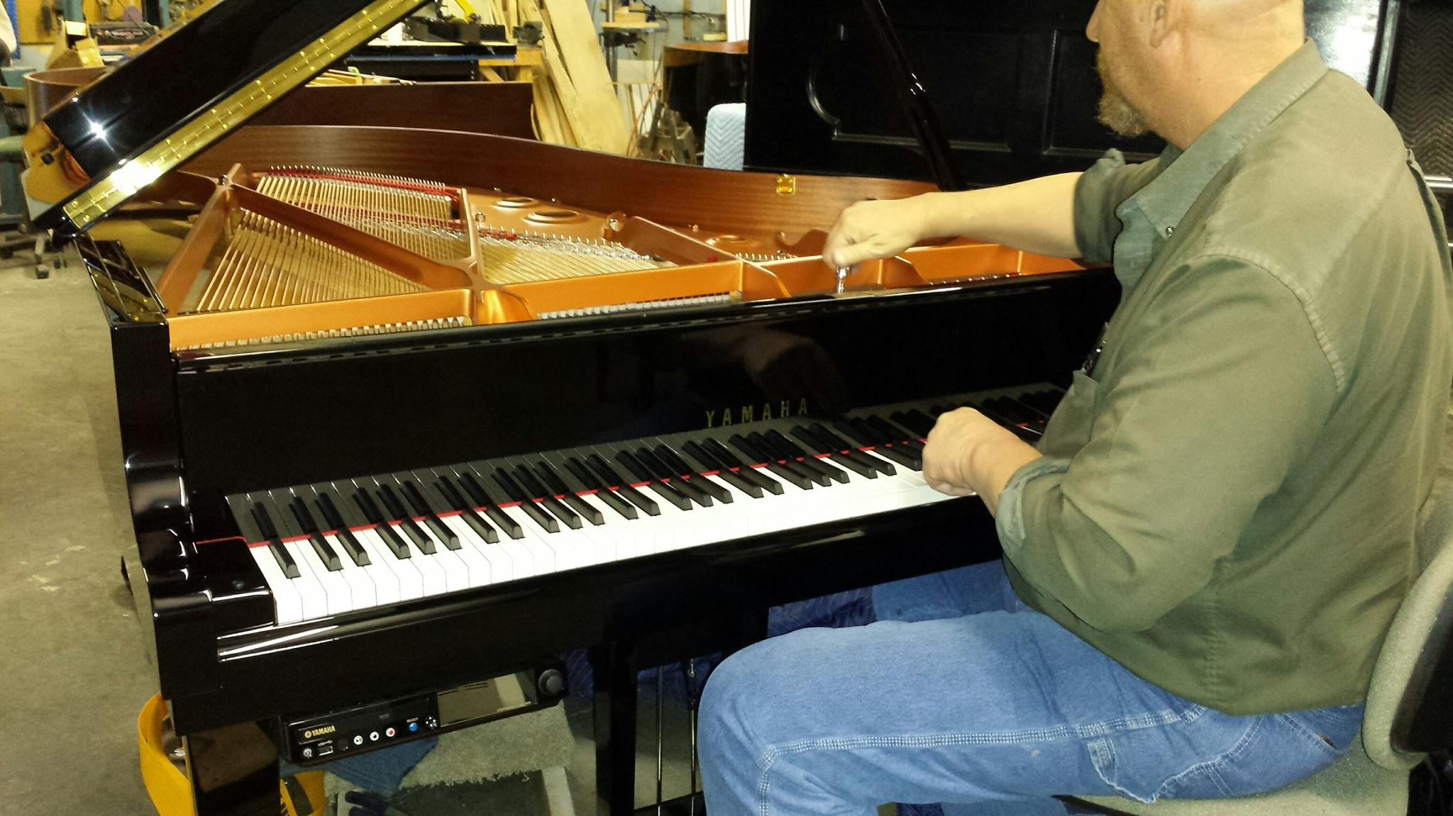 Gist piano tuning being done by a Gist employee