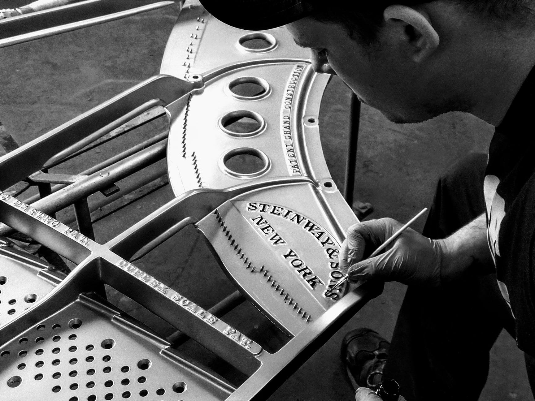 Employee completing Piano restoration at Gist