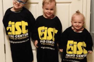 3 young kids wearing Gist Piano shirts